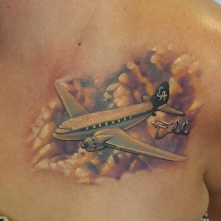 Plane in Clouds Tattoo by Jake Behrmann