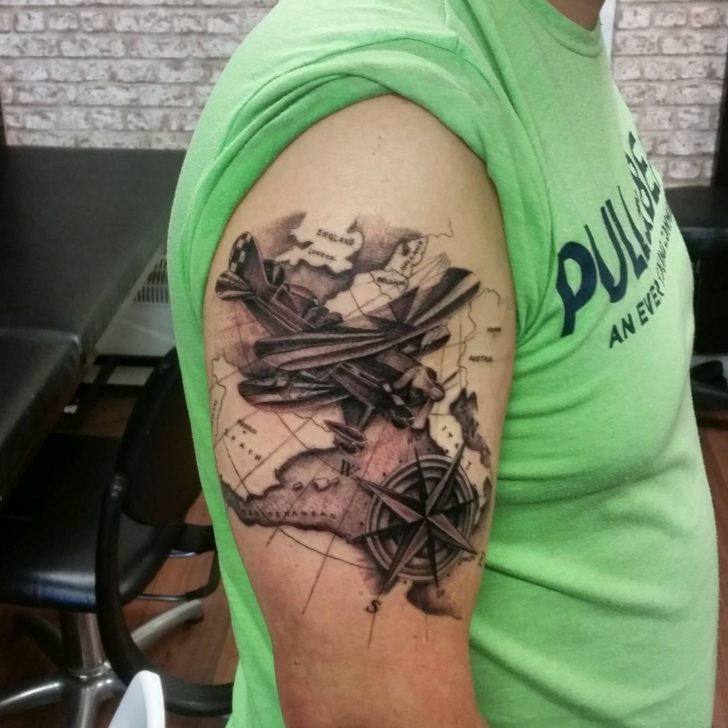Plane on Map Tattoo on Shoulder by Dave Stewart