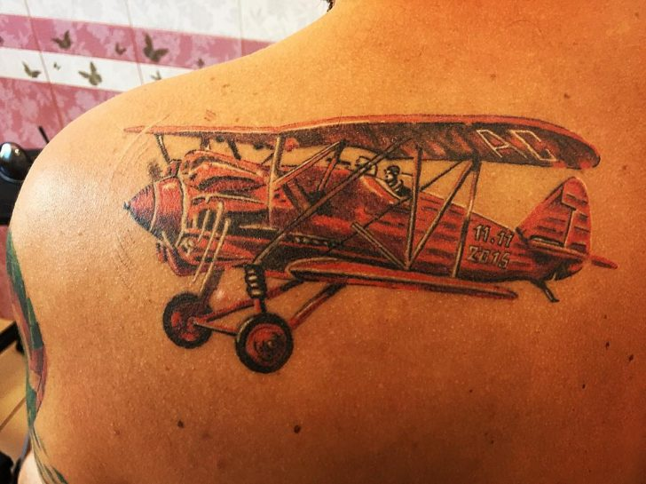 Shoulder Blade Plane Tattoo Orange by kiryhatattoo