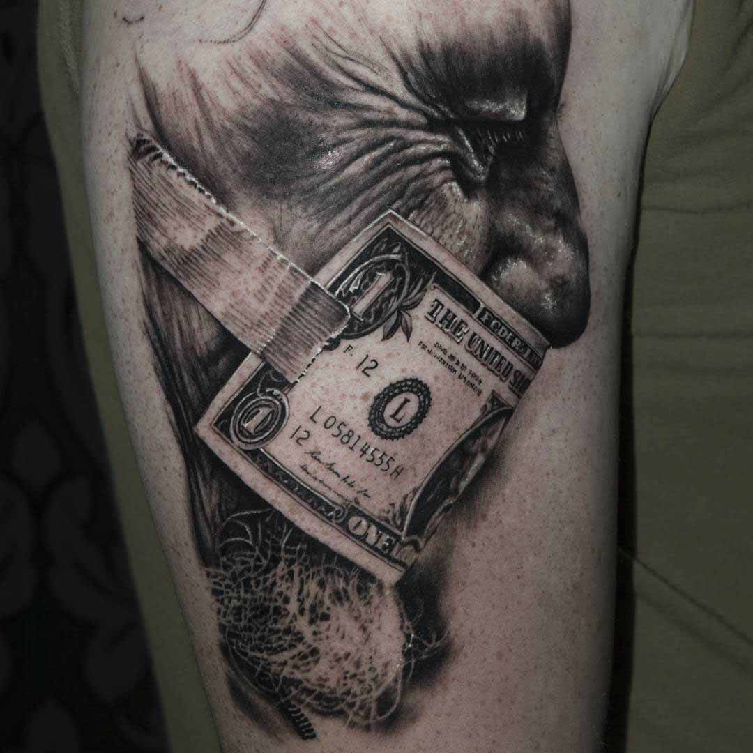 shoulder tattoo black and grey dollar