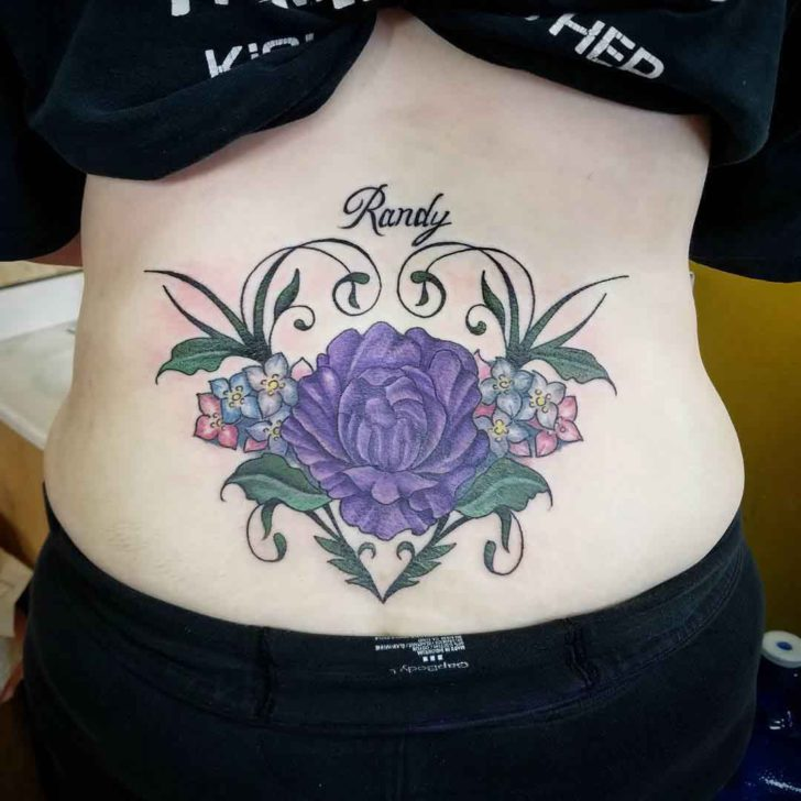 flower tattoo on lower back