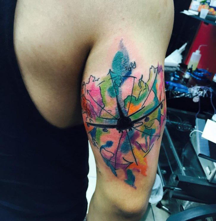 Watercolor Plane Tattoo on Bicep by tattoosbytk.dc
