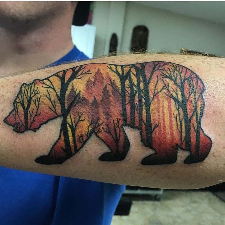 bear tattoo on arm silhouette forest inside
