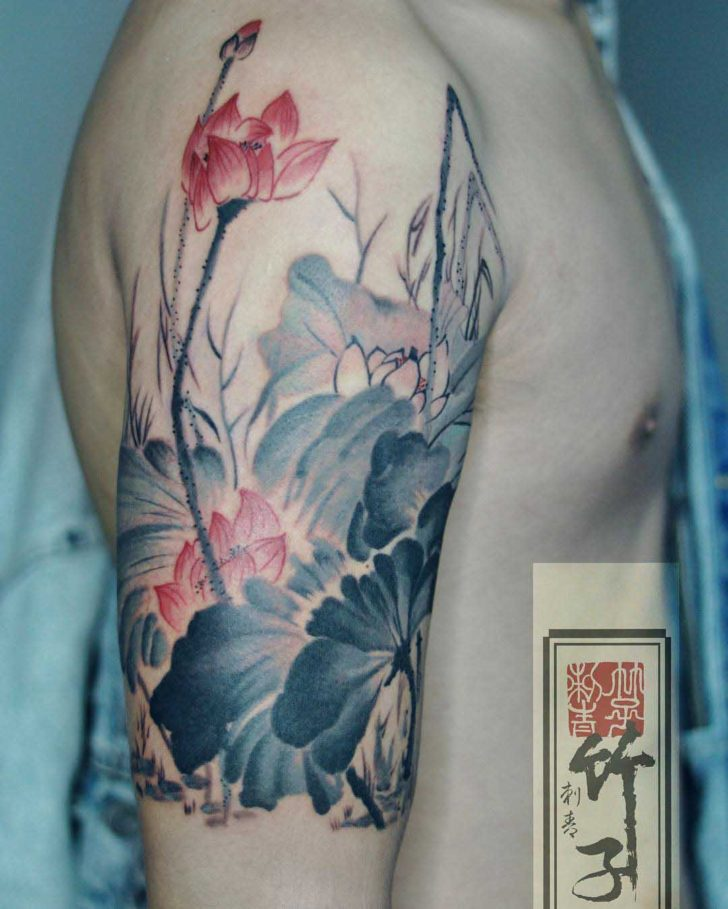 shoulder flowers tattoo pale colors