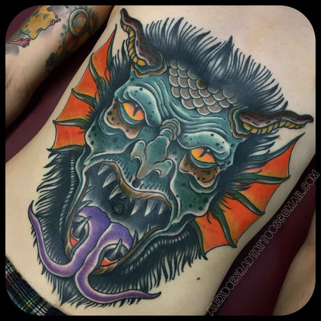 stomach tattoo demon