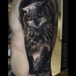 realistic owl tattoo on shoulder