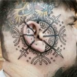 Runic Ear Tattoo
