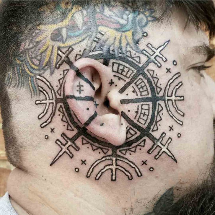ear tattoo viking compass