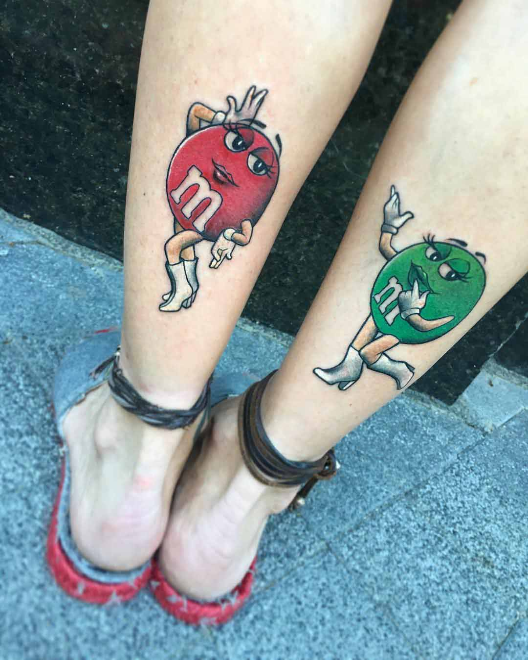 M&M tattoos on calves for sisters