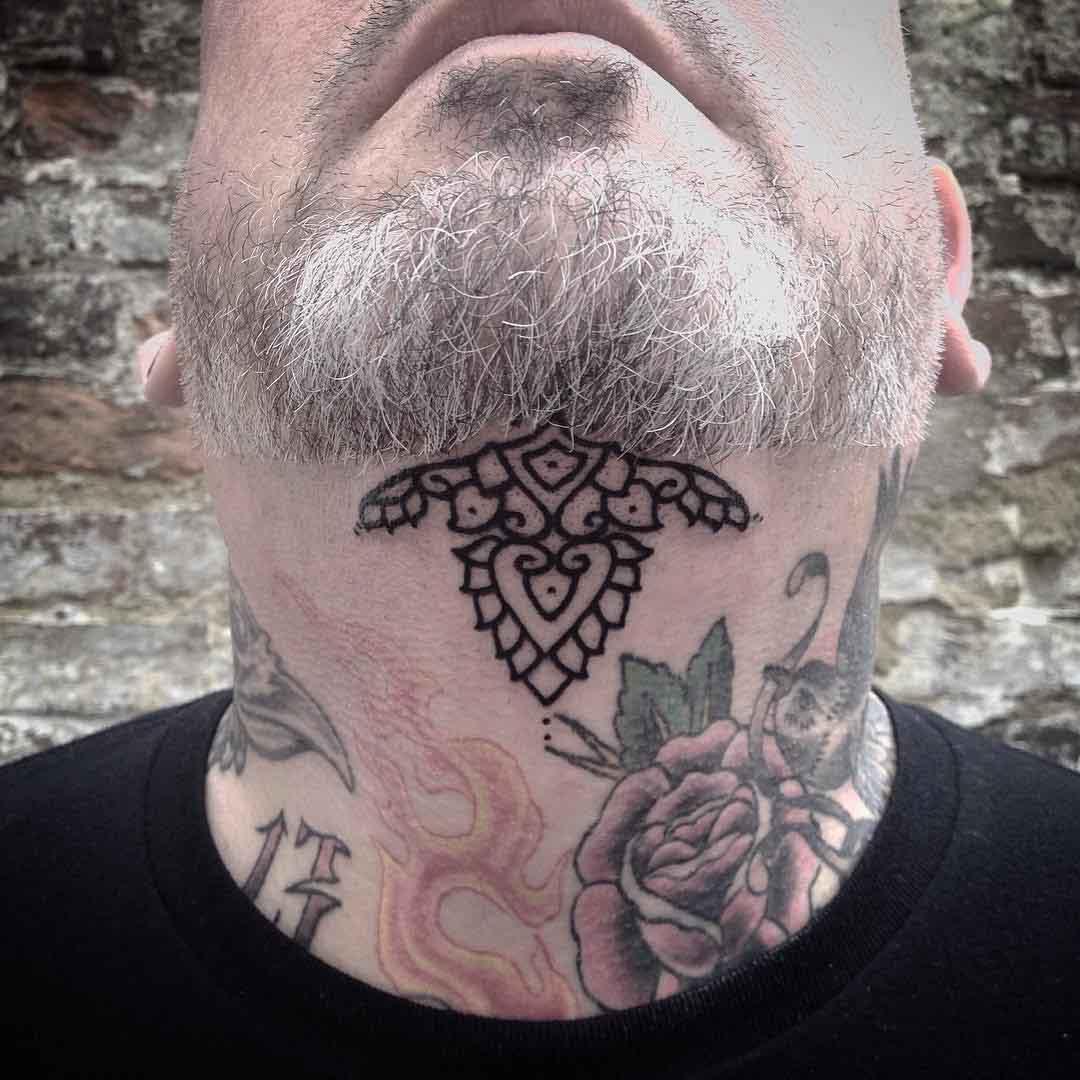 simple tattoo under chin