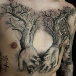 chest tattoo woden hands