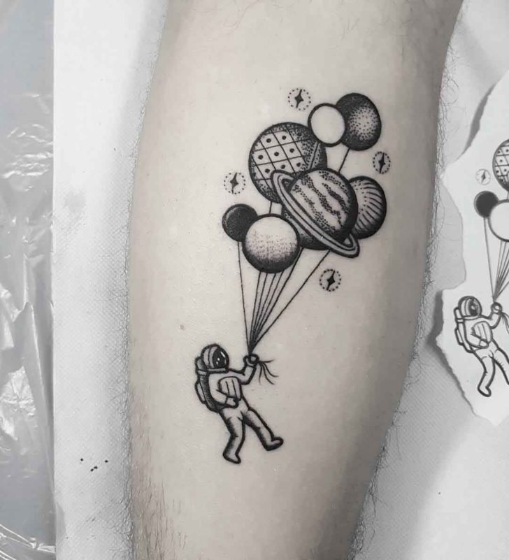 astronaut tattoo with balloons
