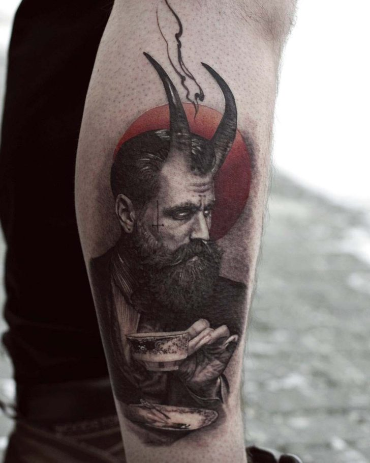 calf tattoo devil man