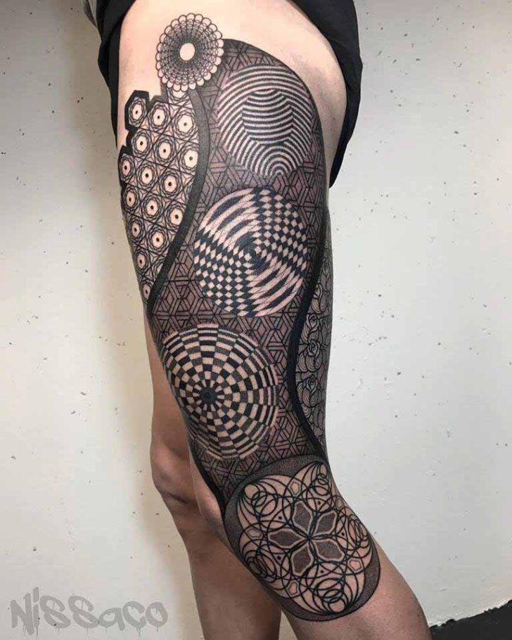 geometric leg tattoo on thigh and hip