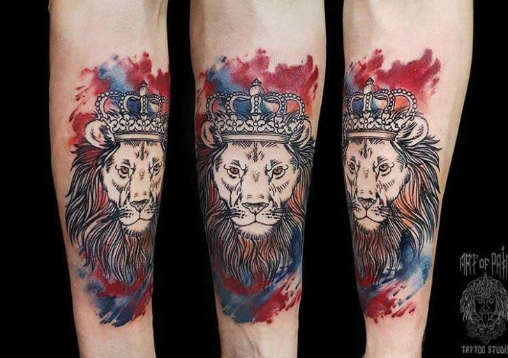arm tattoo lion with crown