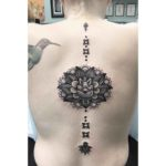lotus tattoo on spine