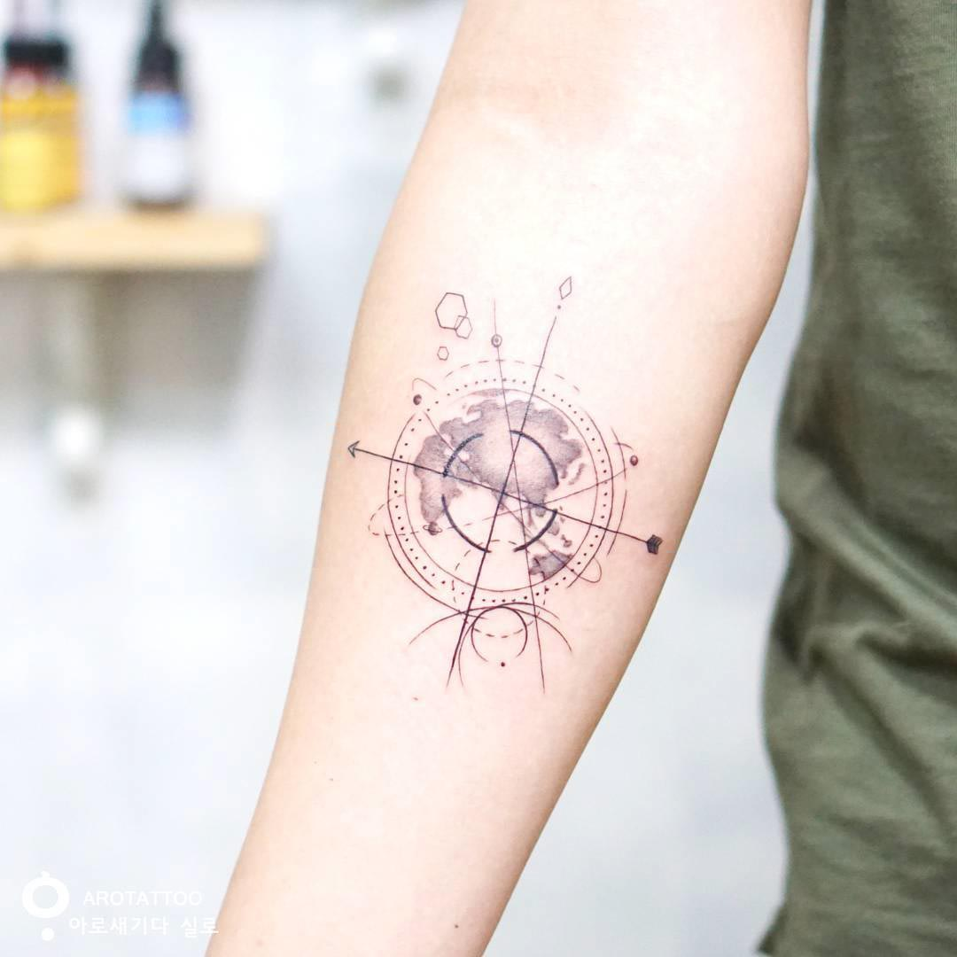 geometrical world map tattoo on bicep