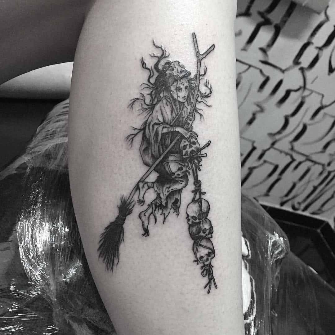 tattoo of witch with skulls