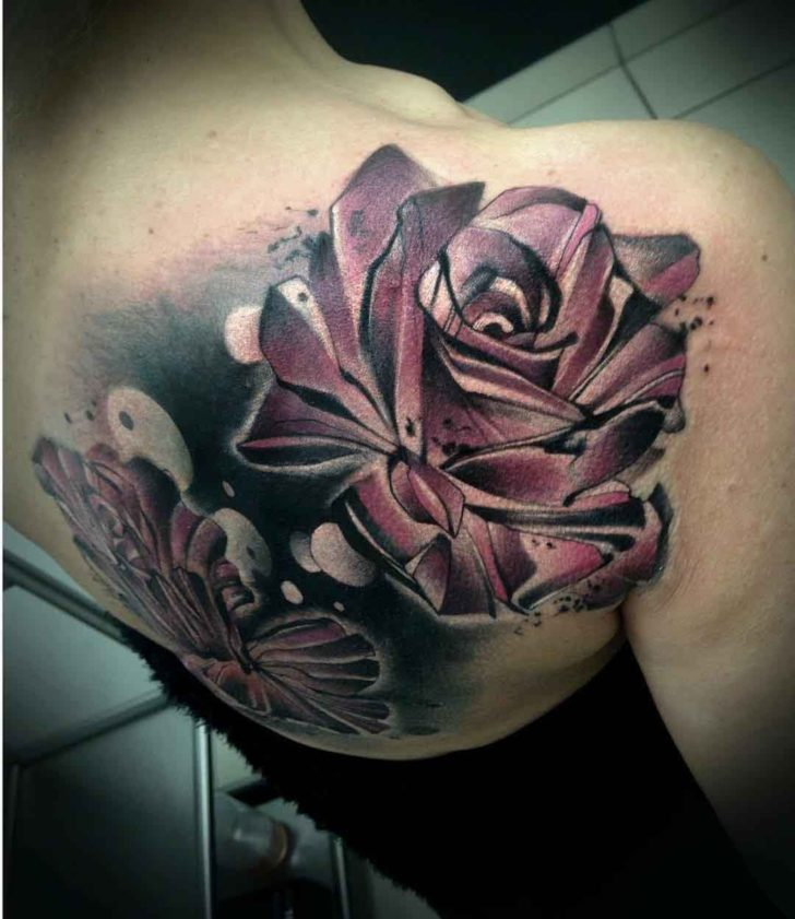 shoulder blade roses tattoo on girl