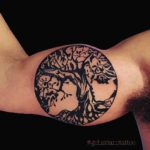 bicep tree tattoo black