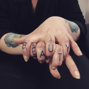 Beauty Tattoo on Fingers