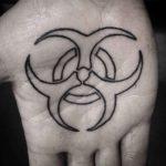 Biohazard tattoo on palm