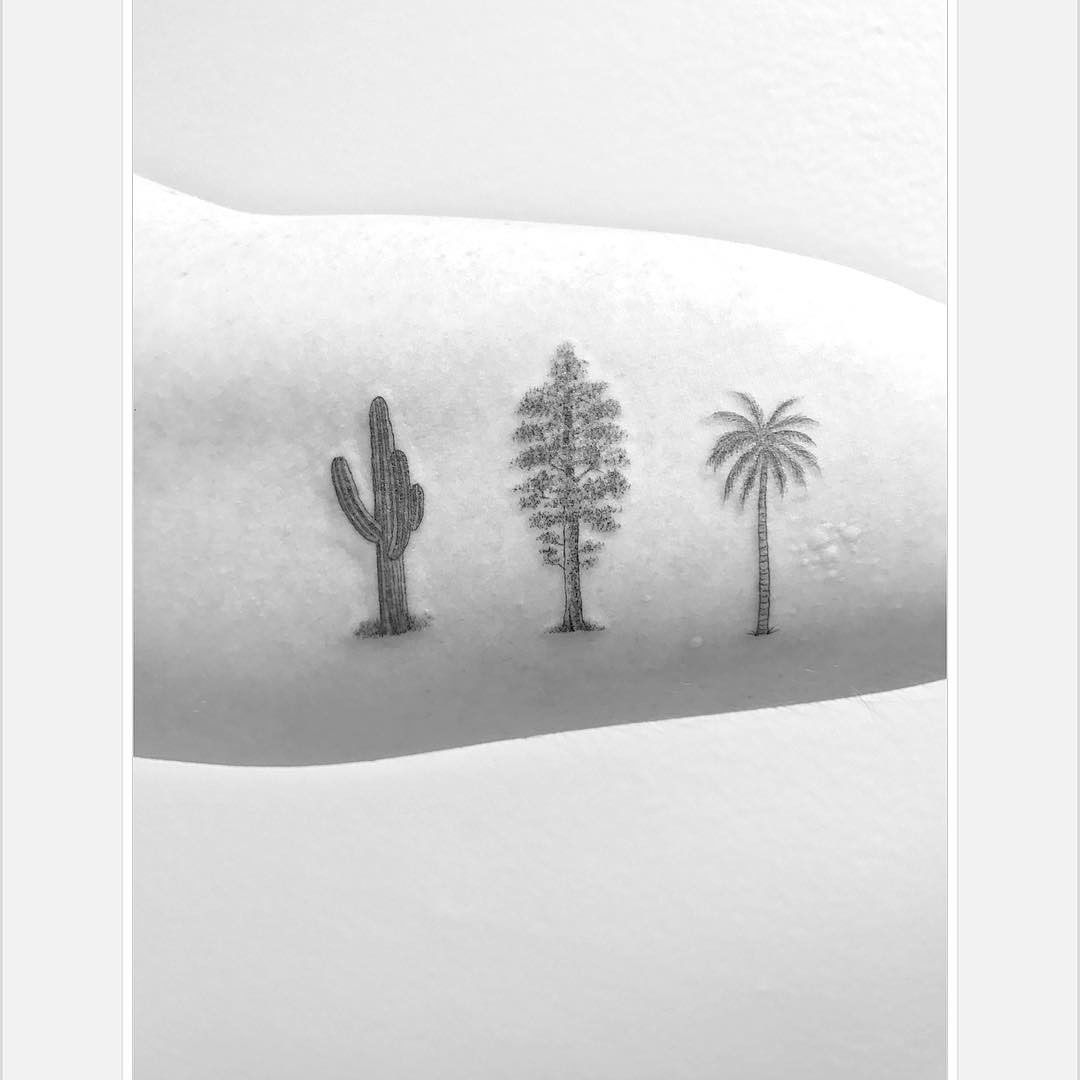 bicep tattoo trees