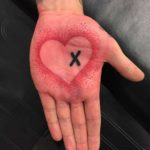 Crossed Heart Palm Tattoo