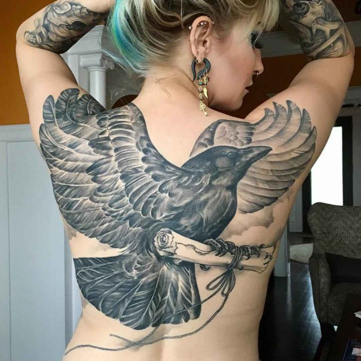 crow tattoo on girl's back