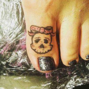 Girl Skull Tattoo on Toe