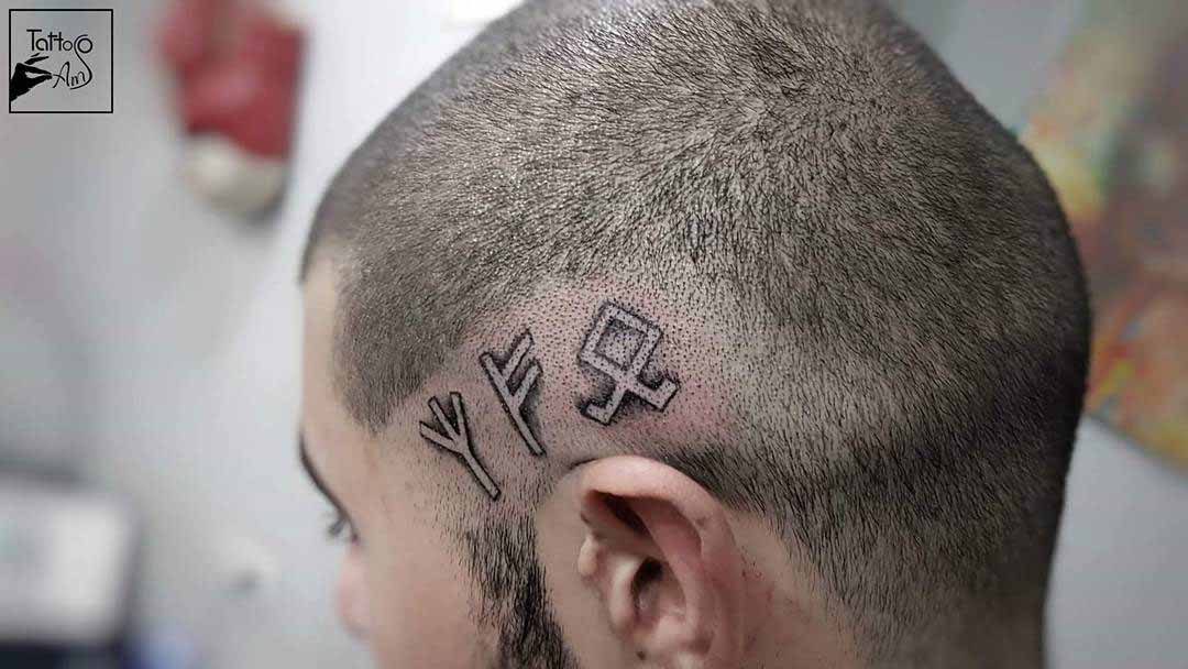 head tattoo with runes