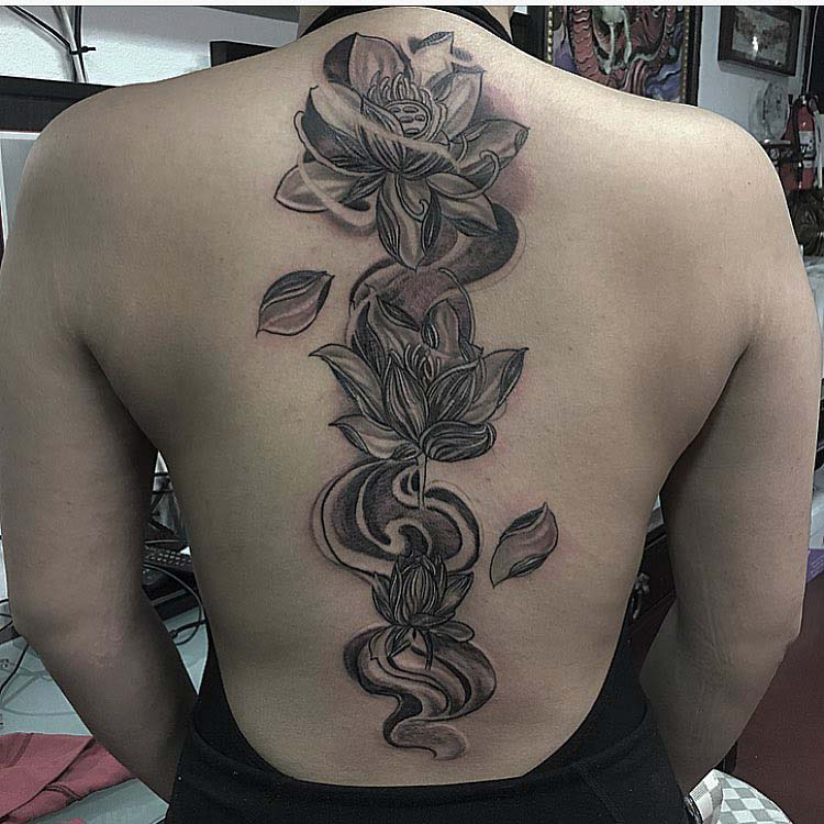 lotuses tattoo along spine