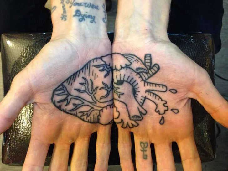 Matching Heart Tattoo on Palms by Elijah Pashby