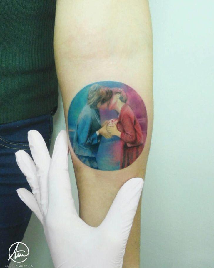 arm tattoo kiss