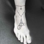 ankle tattoo necklace on foot