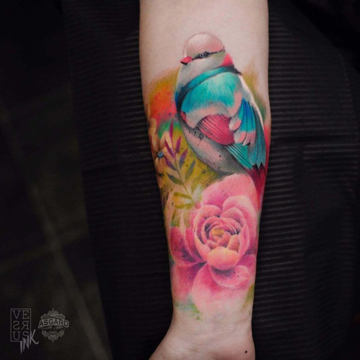 colorful bird tattoo on arm with flowers