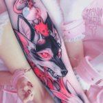 pink predator tattoo on arm