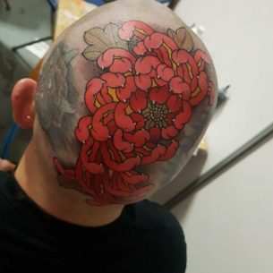 Flower Head Tattoo