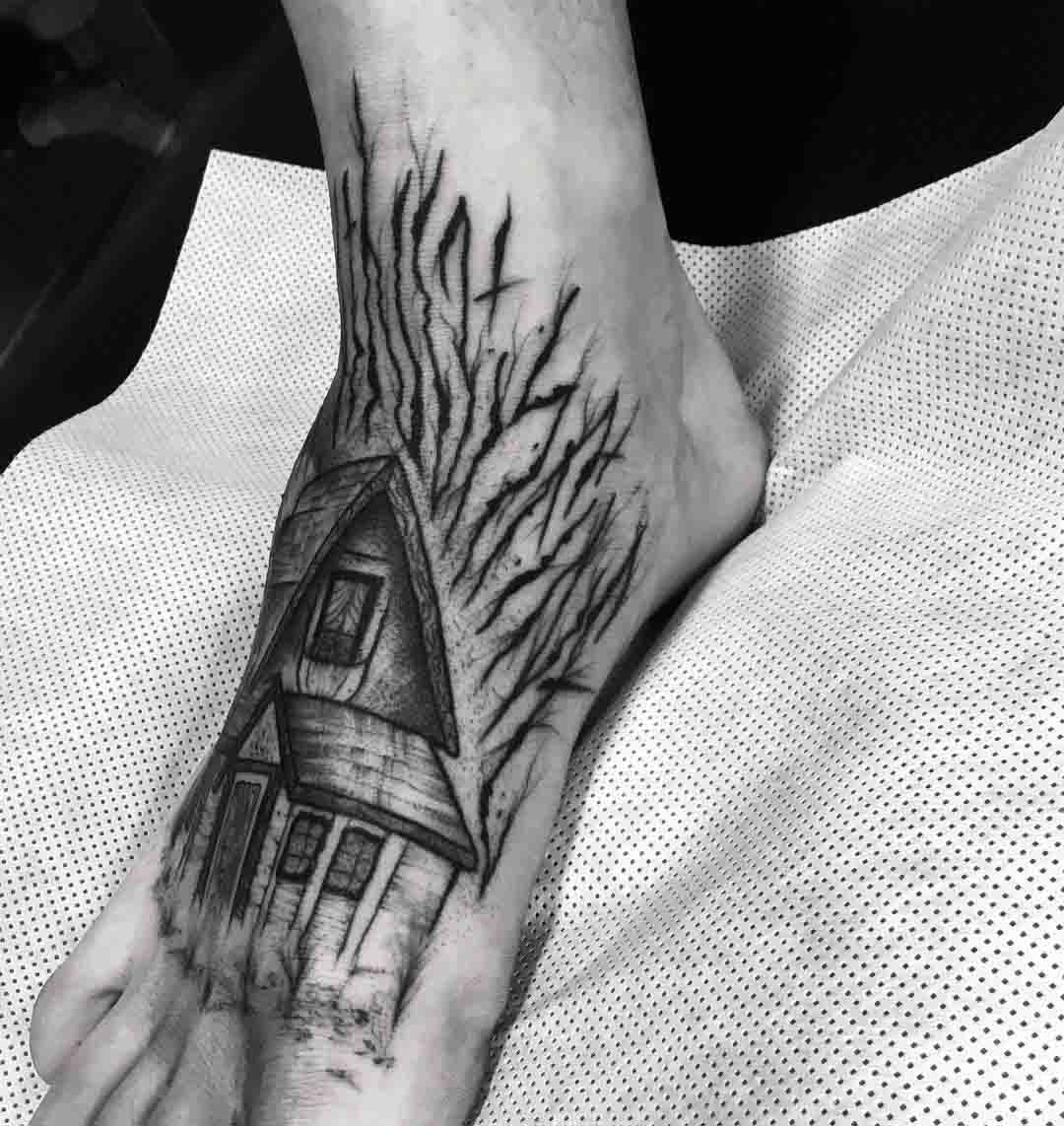 house tattoo on foot