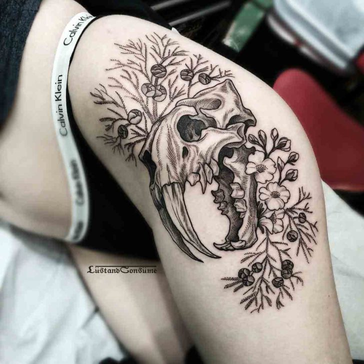 cat skull tattoo on hip girl