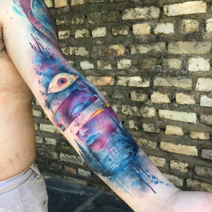 arm watercolor mask tattoo idea