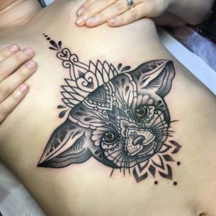 Animalistic Tattoo Under Brests