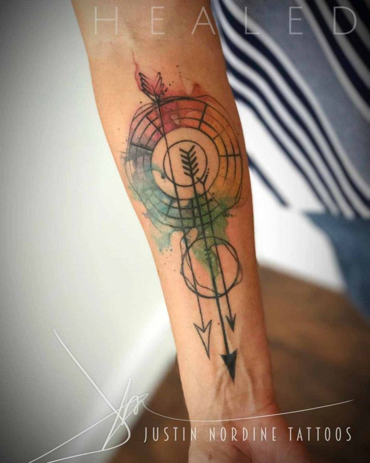 geometry tattoo arrows on forearm