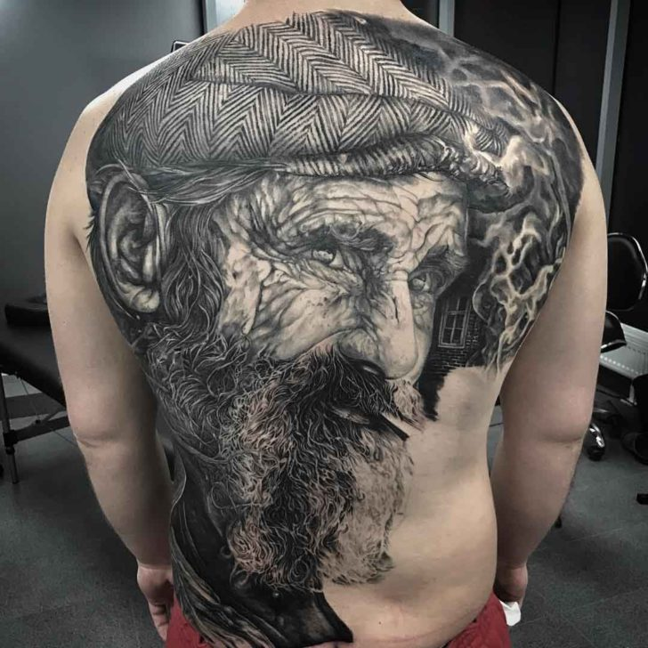 black and grey realistic full back tattoo