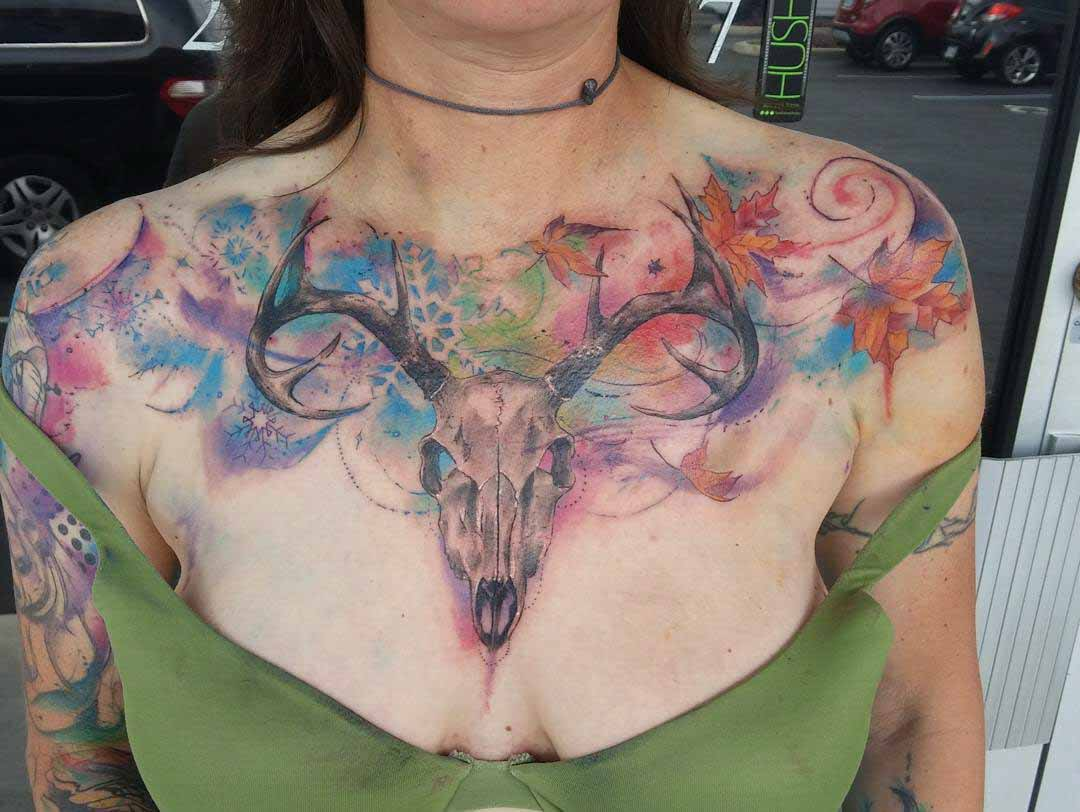 ram skull watercolor tattoo on chest
