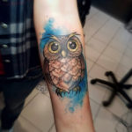 cute owl tattoo on arm