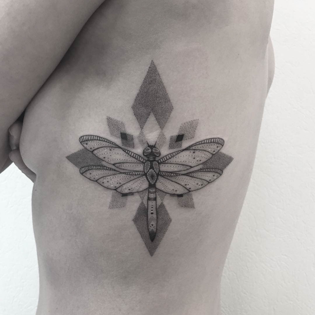 rib tattoo dragonfly