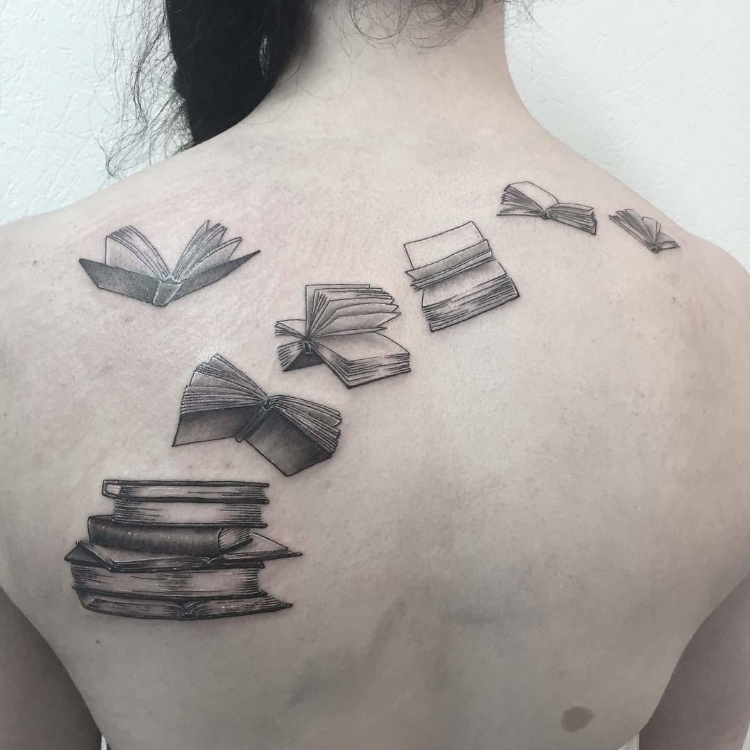 back tattoo books flying