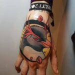 Neo-Traditional Penguin Tattoo on Hand