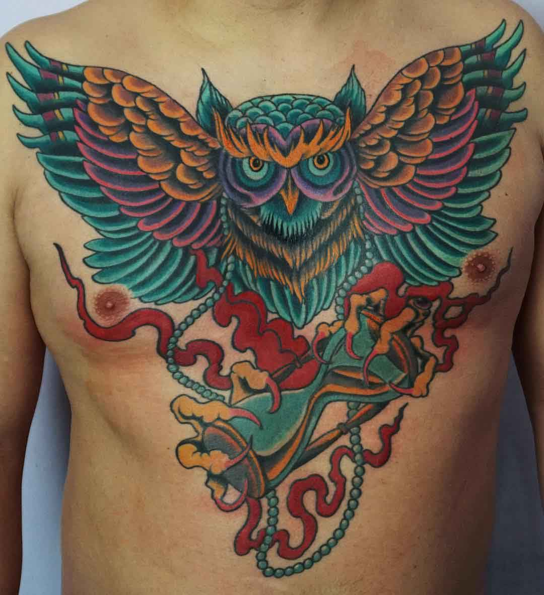 colorful owl tattoo on chest